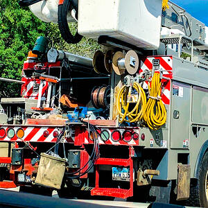 Linemen carry Mueller Electric's protective grounding equipment on their trucks; protective grounding equipment; utility grounding; high-voltage grounding; grounding power lines; de-energized lines; electrical